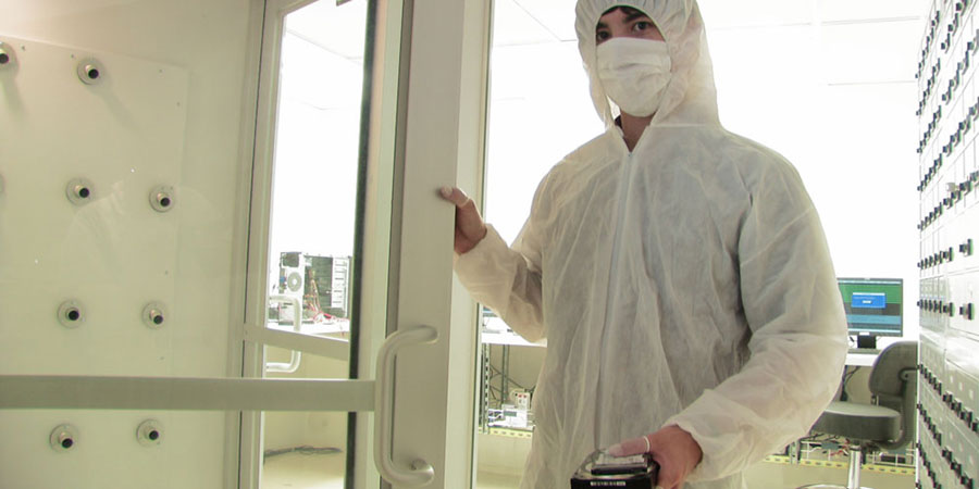 Entering ISO 5 / Class 100 certified data recovery cleanroom air shower unit to get rid of dust on body before entering work stations