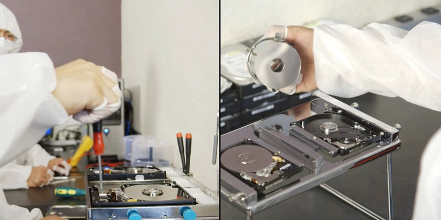Data recovery procedure - swapping platters between donor drive and target drive in dust-free cleanroom lab